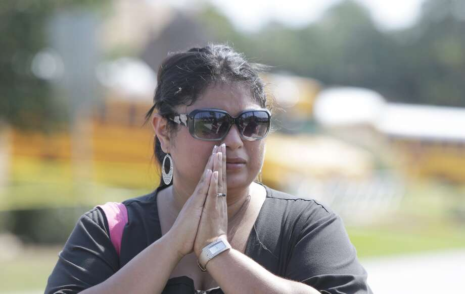 Denise Loera ,a parent of twin senior boys, waits outside Spring High School where a student was fatally stabbed and three others injured Wednesday, Sept. 3, 2013. (Melissa Phillip/ Houston Chronicle)