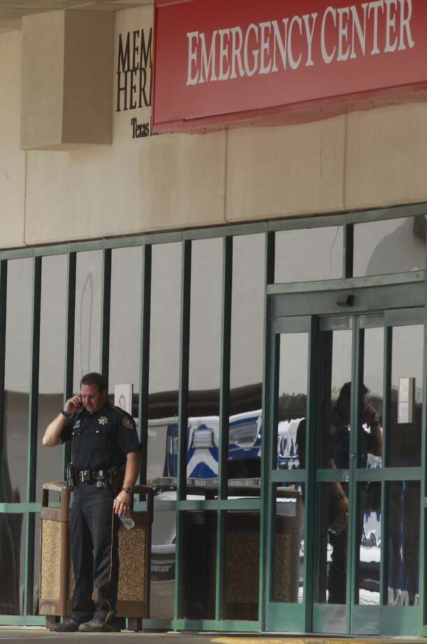 A police officer stands outside Memorial Hermann hospital on Wed., Sept. 4. Two people injured in a stabbing at Spring High School were taken to the hospital by Life Flight.  Photo: Cody Duty, Chronicle