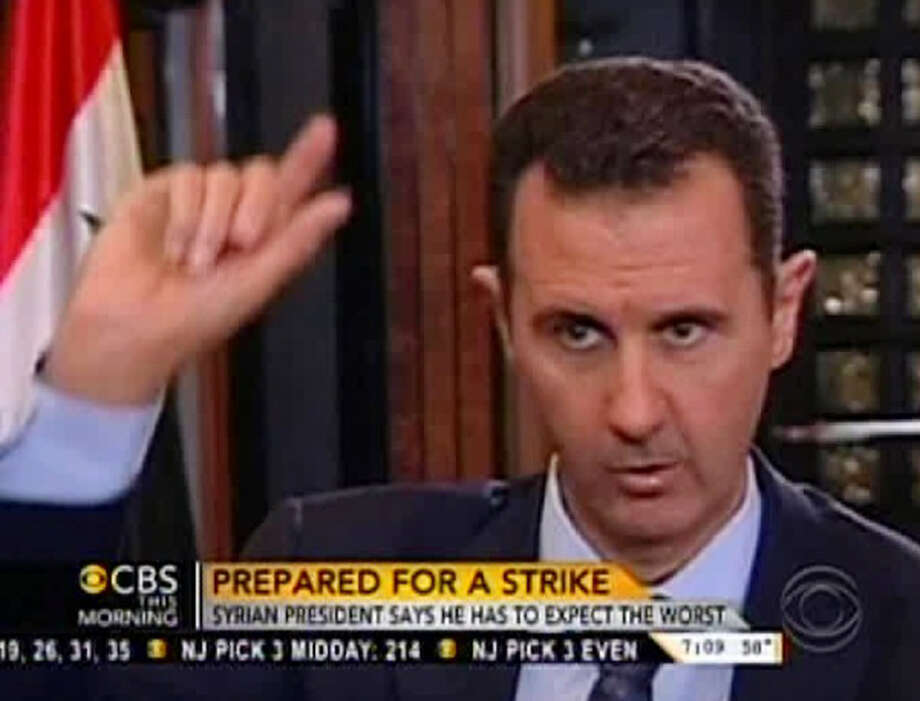 "In this frame grab from video taken Sunday, Sept. 8, 2013, and provided by ""CBS This Morning,"" Syrian President Bashar Assad responds to a question from journalist Charlie Rose during an interview in Damascus, Syria. Assad warned in the interview broadcast Monday on CBS there will be retaliation against the U.S. for any military strike launched in response to the alleged chemical weapons attack. Assad said, ""You should expect everything."" Photo: CBS This Morning"