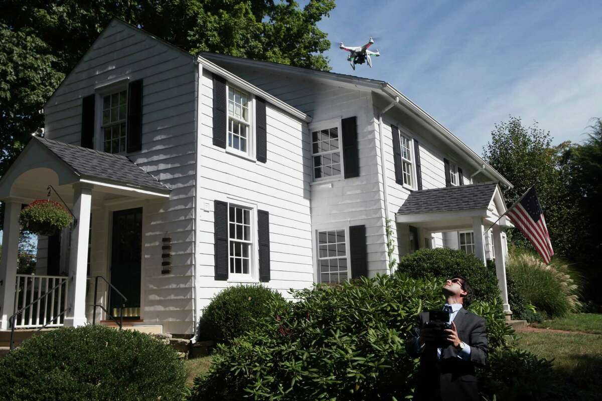 Mark Pires, a realtor with Coldwell Banker, flies his custom built quad copter, which simultaneously shoots stills and video, at a Fairfield home on Monday, Sept. 9, 2013. Pires is the first Real Estate agent to offer this state of the art aerial service personally.