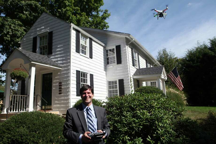 Mark Pires, a realtor with Coldwell Banker, flies his custom built quad copter, which simultaneously shoots stills and video, at a Fairfield home on Monday, Sept. 9, 2013. Pires is the first Real Estate agent to offer this state of the art aerial service personally. Photo: B.K. Angeletti / Connecticut Post Freelance