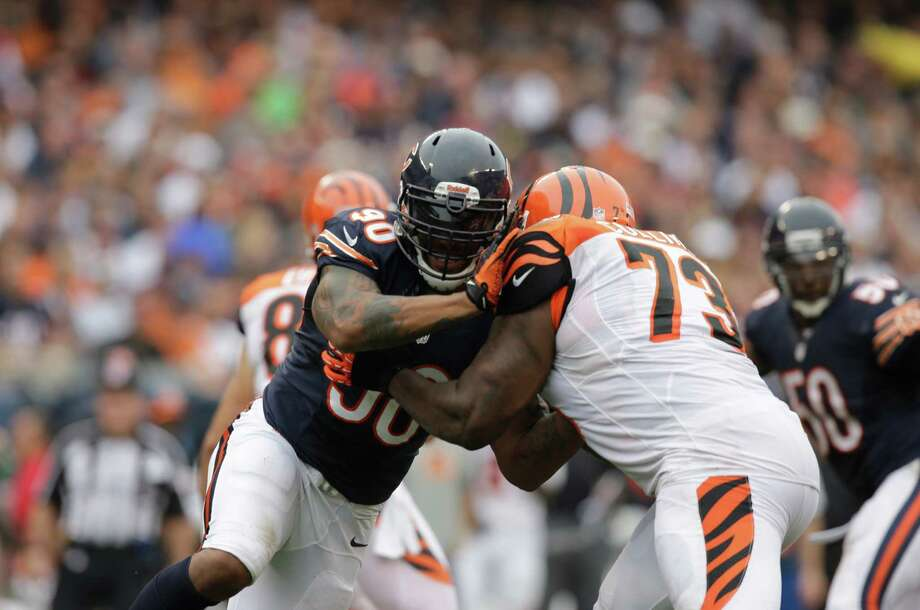 Chicago Bears defensive end Julius Peppers (90) battles against Cincinnati Bengals tackle Anthony Collins (73) during the second half of an NFL football game, Sunday, Sept. 8, 2013, in Chicago. (AP Photo/Nam Y. Huh) Photo: Nam Y. Huh, STF / AP