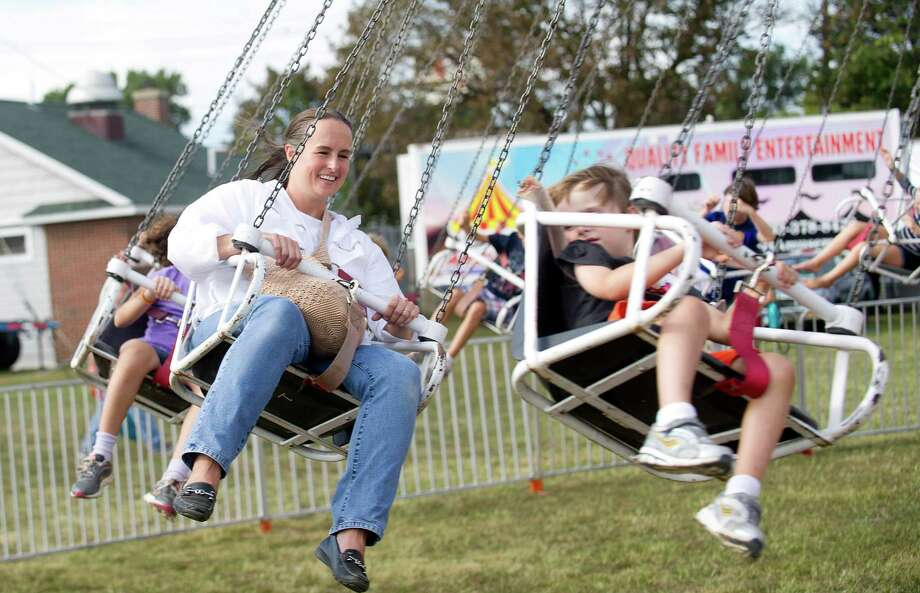 Attendees on the Zumur swing ride at the Norwalk Seaport Association's 37th annual oyster festival in Norwalk, Conn. on Saturday, September 7, 2013. 18 people were injured Sunday when the ride malfunctioned and the Zumur ride's cars slammed into each other when the swing-style ride abruptly stopped. Photo: Lindsay Perry / Stamford Advocate