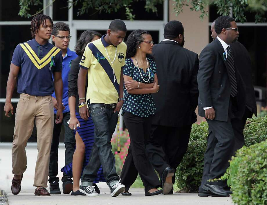 Family and friends arrive at Spring Baptist Church for the funeral services for Spring High School student Joshua Broussard who was killed last Wednesday, Aug. 4 on campus, Monday, Sept. 9, 2013, in Spring. Photo: James Nielsen, Houston Chronicle / © 2013  Houston Chronicle