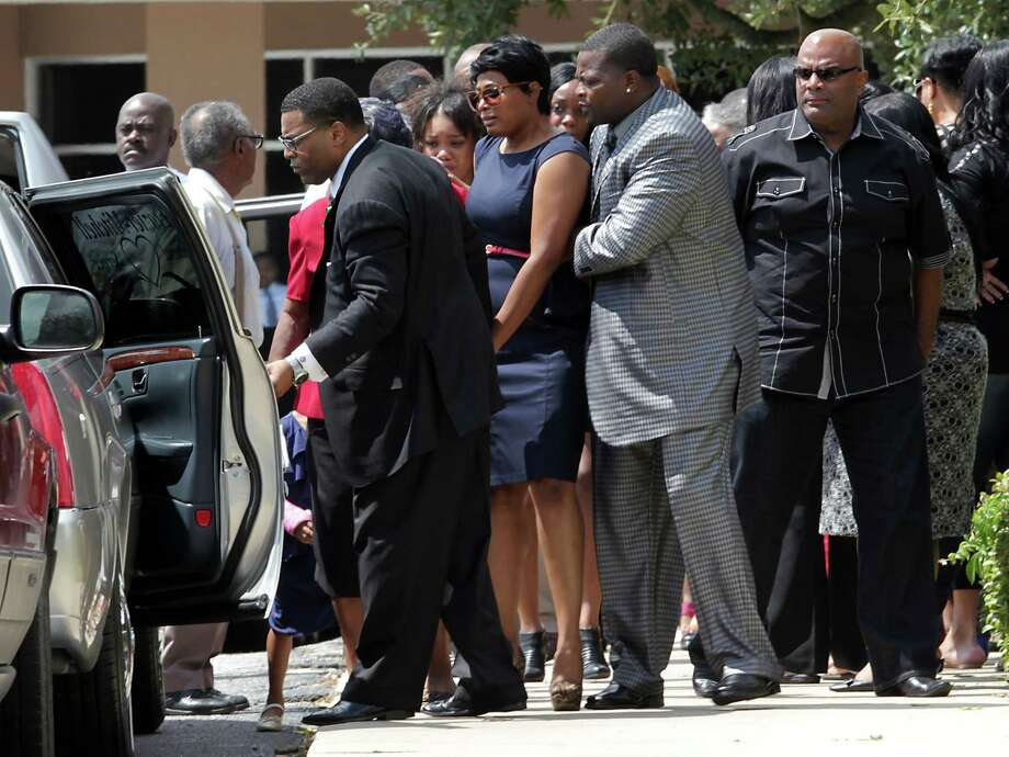 Family and friends leave Spring Baptist Church after the funeral services for Spring High School student Joshua Broussard who was killed last Wednesday, Aug. 4 on campus, Monday, Sept. 9, 2013, in Spring. Photo: James Nielsen, Houston Chronicle / © 2013  Houston Chronicle
