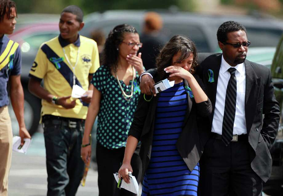 Students and parents leave the Spring Baptist Church after the memorial service of Joshua Broussard on Monday, Sept. 9, 2013, in Spring. Photo: Mayra Beltran, Houston Chronicle / © 2013 Houston Chronicle