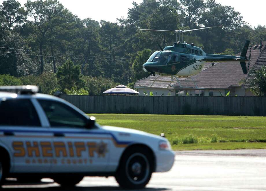 Harris County Sheriff's helicopter lands just outside Spring Baptist Church in preparation for the memorial service of Joshua Broussard on Monday, Sept. 9, 2013, in Spring. Photo: Mayra Beltran, Houston Chronicle / © 2013 Houston Chronicle
