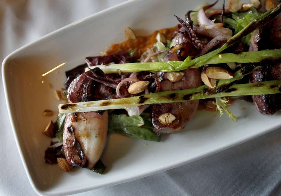 Calamari on a bed of greens. Photo: Brant Ward, The Chronicle