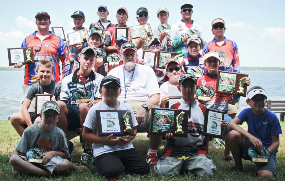 Youth anglers and Ignition Bass' Director, Jim Brockman, pause for a group picture.  Photo by Alison Hart The Lakecaster Magazine