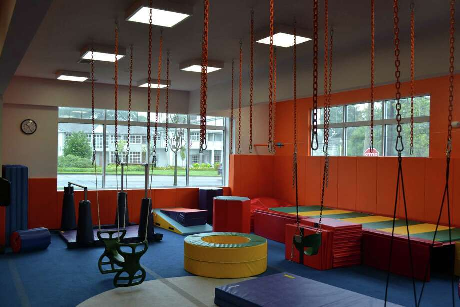 Swings and floor mats await children in the indoor play area at Kidville, a developmental-acvitiy center for young children about to open at 1572 Post Road East, the site of the former Goodwill outlet. Photo: Contributed Photo / Westport News