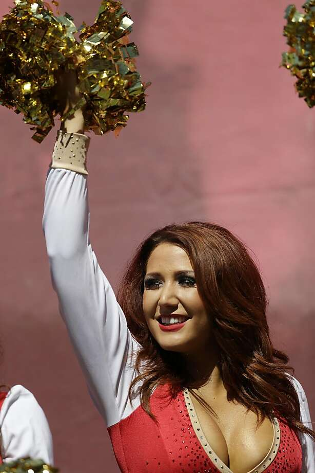 A San Francisco 49ers cheerleader performs before an NFL football game against the Green Bay Packers in San Francisco, Sunday, Sept. 8, 2013. (AP Photo/Marcio Jose Sanchez) Photo: Marcio Jose Sanchez, Associated Press