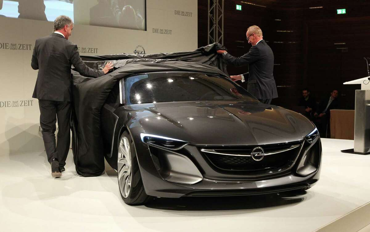 Mark Adams (left), Vice President of General Motors Europe, and Karl-Thomas Neumann, CEO of German car maker Opel, unveil the new Opel Monza Concept at the IAA auto show in Frankfurt, Germany, on Sept. 9, 2013.