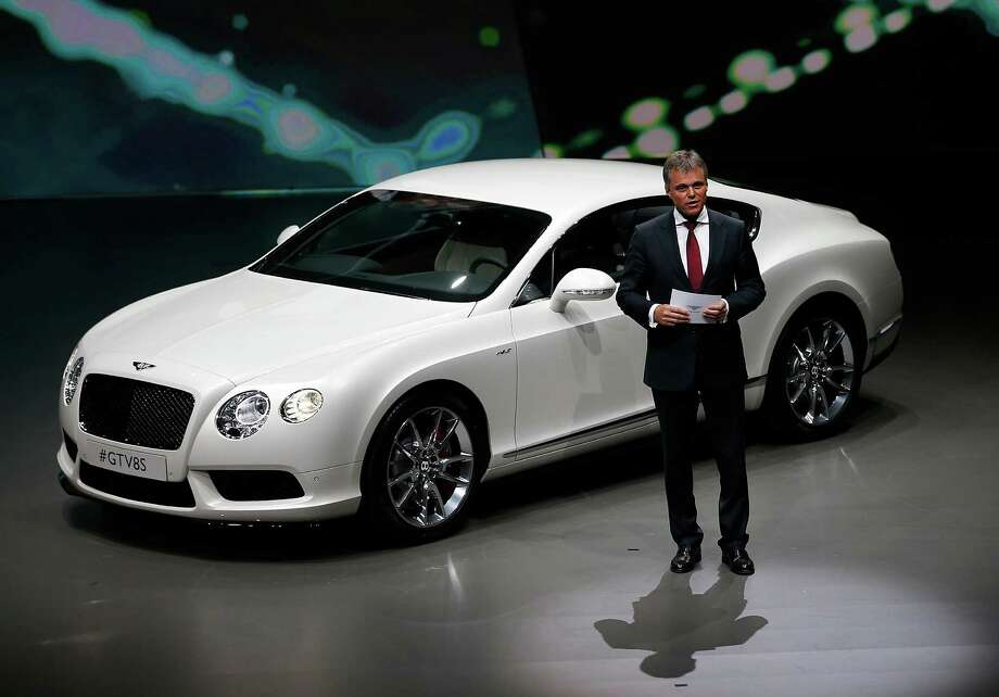 Wolfgang Schreiber, CEO of Bentley Motors and Bugatti, presents the new Bentley GT V8S during a preview by the Volkswagen Group prior to the 65th Frankfurt Auto Show in Frankfurt, Germany, Monday, Sept. 9, 2013. Photo: AP