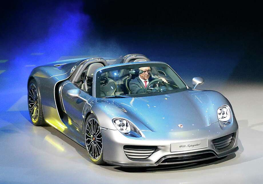 Porsche AG CEO Matthias Mueller steers the new Porsche 918 Spyder during a preview by the Volkswagen Group prior to the 65th Frankfurt Auto Show in Frankfurt, Germany, Monday, Sept. 9, 2013. Photo: AP