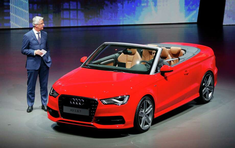 Audi CEO Rupert Stadler presents the new Audi A3 cabriolet during a preview by the Volkswagen Group prior to the 65th Frankfurt Auto Show in Frankfurt, Germany, Monday, Sept. 9, 2013. Photo: AP