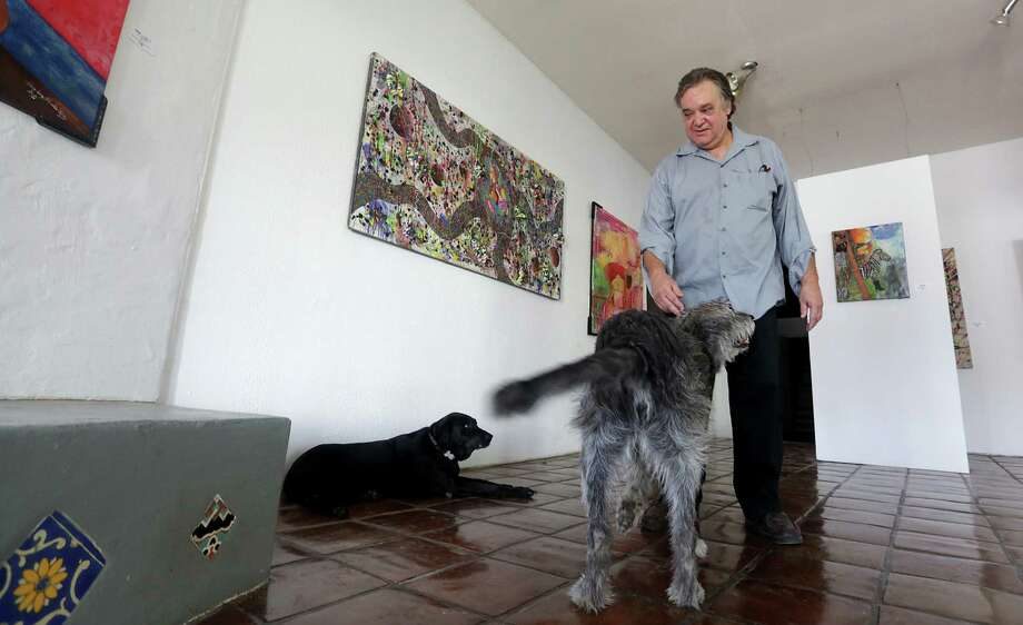 Ray Palmer allows this dogs Zeke, right, and Lila roam his gallery studio space at High Wire Arts.  Monday, August 26, 2013. Photo: Bob Owen, San Antonio Express-News / © 2012 San Antonio Express-News