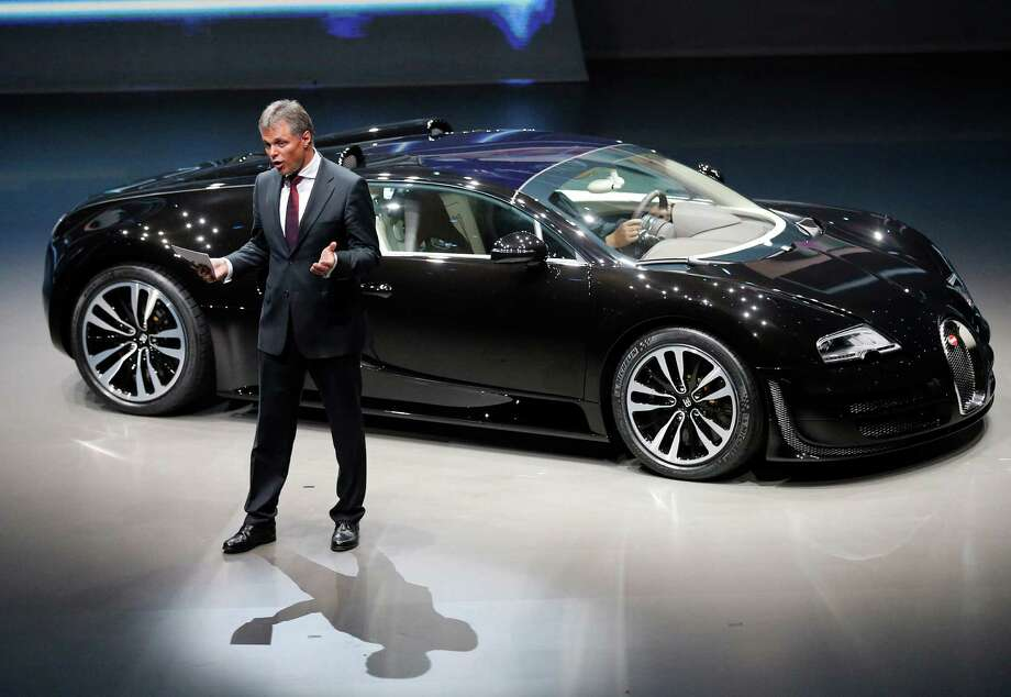 Wolfgang Schreiber, CEO of Bentley Motors and Bugatti, introduces the new Bugatti Veyron during a preview by the Volkswagen Group prior to the 65th Frankfurt Auto Show in Frankfurt, Germany, Monday, Sept. 9, 2013. Photo: AP