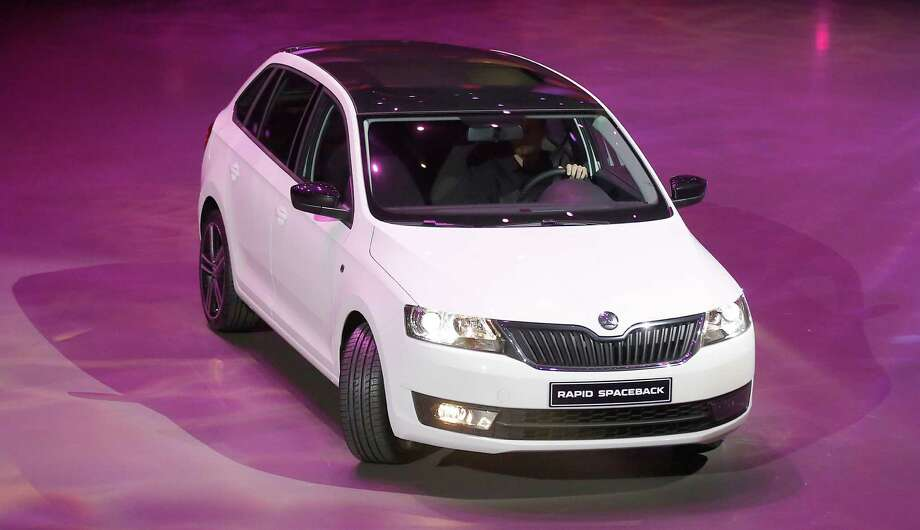 The new Skoda Rapid Spaceback is displayed during a preview by the Volkswagen Group prior to the 65th Frankfurt Auto Show in Frankfurt, Germany, Monday, Sept. 9, 2013. Photo: AP