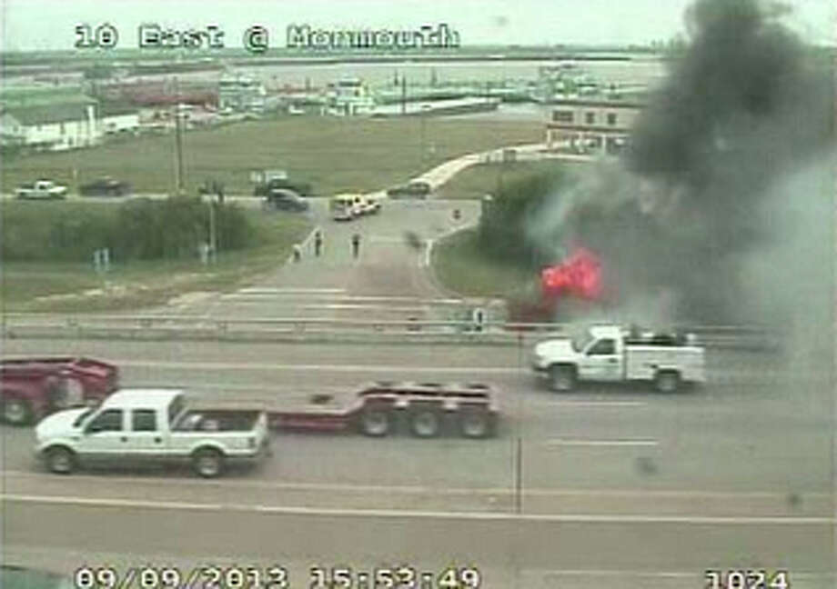 A big rig burns on Interstate 10 East at Monmouth Drive, Sept. 9, 2013. (Houston Transtar)