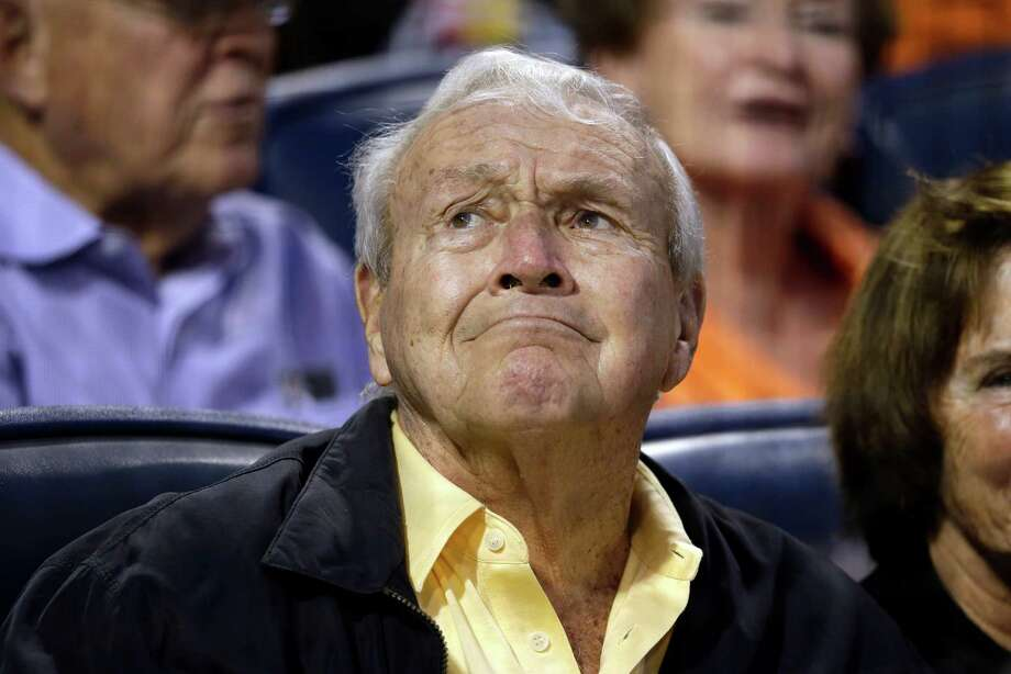 Golf legend Arnold Palmer waits out a rain delay before a baseball game between the Pittsburgh Pirates and Oakland Athletics in Pittsburgh Tuesday, July 9, 2013. (AP Photo/Gene J. Puskar) ORG XMIT: PAGP108 Photo: Gene J. Puskar / AP