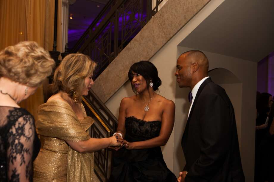 Renee Fleming greets Tiffany and Rick Smith at the  Houston Symphony gala. Photo: Michael Starghill, Jr.