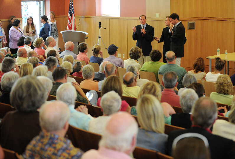 Sen. Richard Blumenthal, left, and Rep. Jim Himes address a packed house during Himes' Town Hall Mee