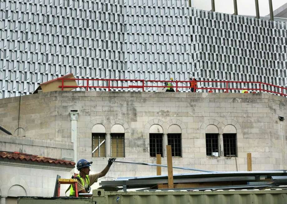 A construction worker looks through building materials as construction continues at the Tobin Center For the Performing Arts, on Friday, Sept. 6, 2013. Photo: Bob Owen, San Antonio Express-News / © 2012 San Antonio Express-News