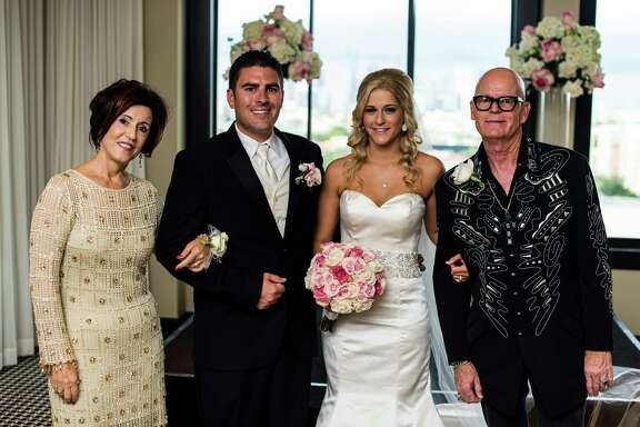 Katy Perry's parents, Mary Hudson, left and Keith Hudson, right, officiated the wedding of Brian and Ashlee Leaumont at Hotel Zaza on Saturday.