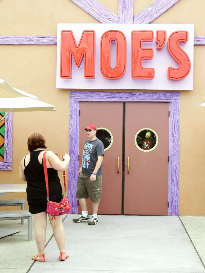 Guests snap photos at the entrance to Moe's Tavern. Photo: John Raoux, Associated Press