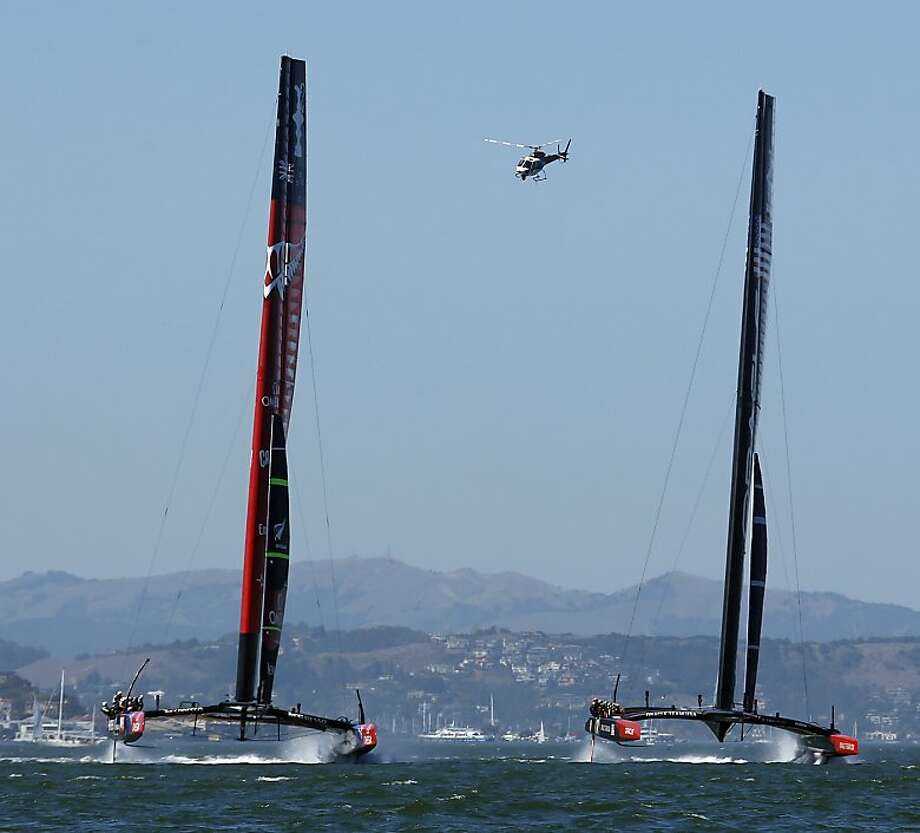Oracle Team USA (right) and Emirates Team New Zealand boats compete towards the first marker during Race 2 of the America's Cup Finals on Saturday, September 7, 2013 in San Francisco, Calif. Photo: Beck Diefenbach, Special To The Chronicle