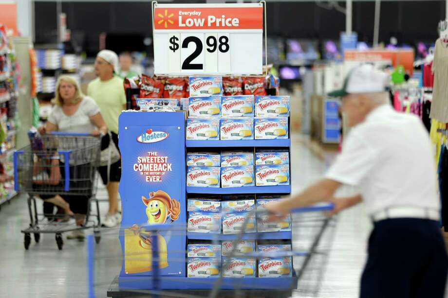 FILE - In this Friday, July 12, 2013, file photo, customers shop at a Wal-Mart, in Bristol, Pa. The Federal Reserve reports how much consumers borrowed in July on Monday, Sept. 9, 2013. (AP Photo/Matt Rourke, File) ORG XMIT: NYBZ202 Photo: Matt Rourke / AP