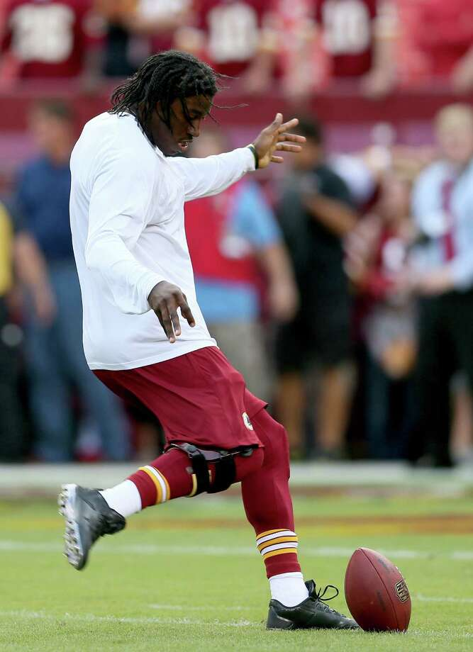 LANDOVER, MD - SEPTEMBER 09:  Quarterback Robert Griffin III #10 of the Washington Redskins kicks the ball before taking on the Philadelphia Eagles at FedExField on September 9, 2013 in Landover, Maryland. Photo: Rob Carr, Getty Images / 2013 Getty Images