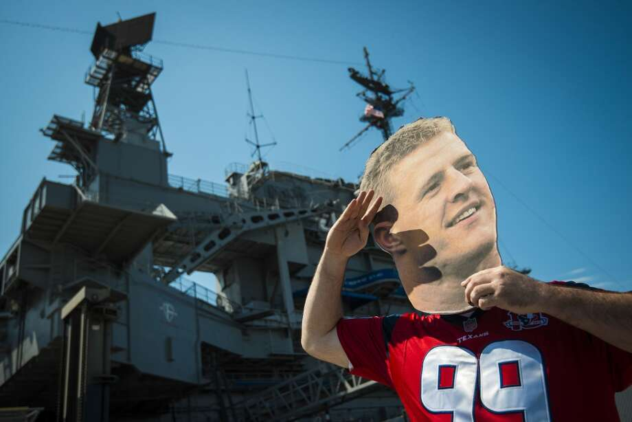 Texans fan Mike McCue mimics J.J.Watt's sack salute near the U.S.S. Midway on Monday, Sept. 9, 2013, in San Diego. Nearly 1,000 Texans fans gathered at the historic aircraft carrier before the team's season-opener against the San Diego Chargers. Photo: Smiley N. Pool, Houston Chronicle