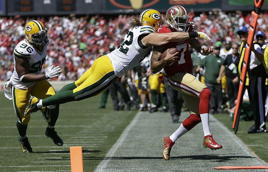 Clay Matthews dives at Colin Kaepernick in the second quarter. The play set off a testy exchange between Matthews and 49ers tackle Joe Staley. Photo: Ben Margot, Associated Press