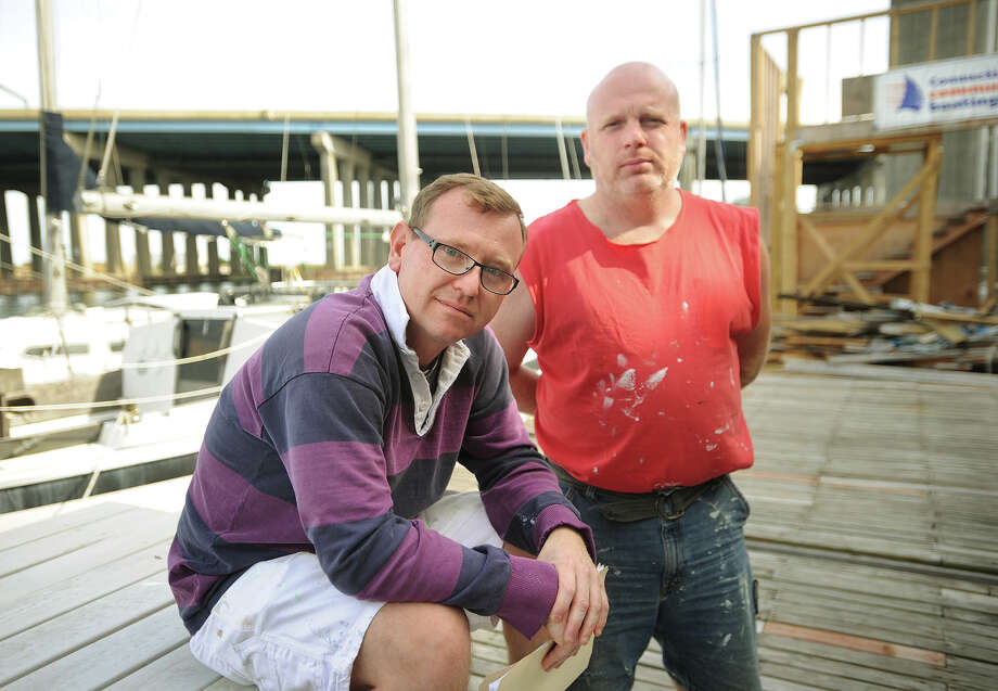 Chris German, left, CEO and founder of Connecticut Community Boating, and board member John Madden, are in a dispute with the City of Bridgeport administation over construction of an education, office, and storage building on their floating pontoon docks on Bridgeport Harbor. Photo: Brian A. Pounds / Connecticut Post