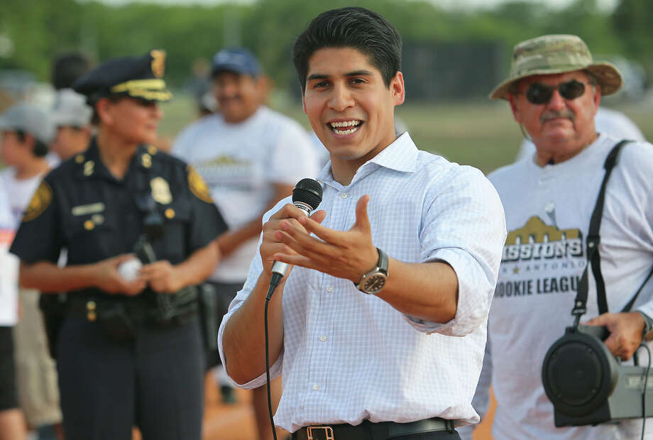 Councilman Rey Saldana speaks before spectators before the SAPD PAL League opens a ball field with Chief Geraldine Garcia throwing the first pitch on July 27, 2012. Photo: San Antonio Express-News / ©2012 San Antono Express-News