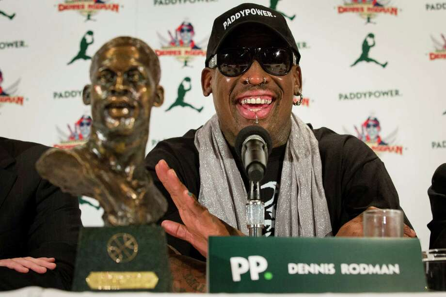 Former NBA basketball player Dennis Rodman speaks to the media during a news conference in New York, Monday, Sept. 9, 2013. Rodman is going back to North Korea, and he says he will bring a team of former NBA players with him. Days after returning from his second trip to visit North Korean leader Kim Jong Un, Rodman announced plans to stage two exhibition games there in January.  (AP Photo/John Minchillo) ORG XMIT: NYJM103 Photo: John Minchillo / FR170537 AP