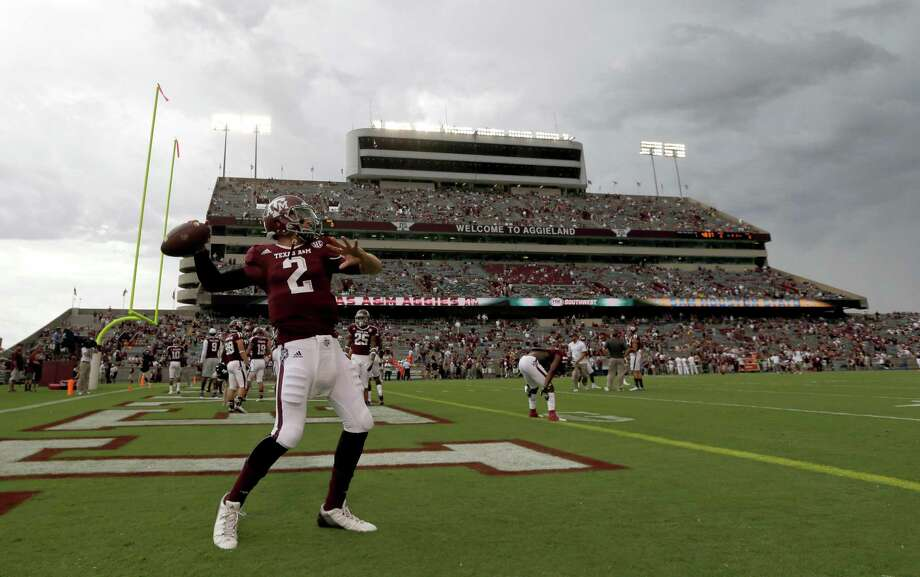Texas A&M quarterback Johnny Manziel (2) throws a pass before an NCAA college football game against Sam Houston State, Saturday, Sept. 7, 2013, in College Station, Texas. (AP Photo/David J. Phillip) ORG XMIT: TXDP104 Photo: David J. Phillip / AP