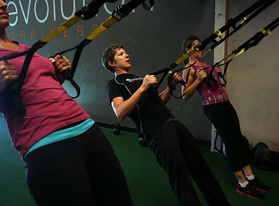 Fitness trainer Ashley Selman is flanked by Sheri King (left) of Los Altos and Carmen Ventura of San Jose. Photo: Liz Hafalia, The Chronicle