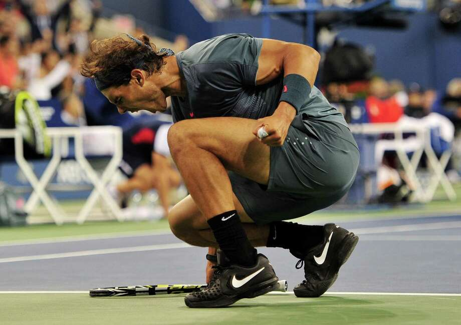 Rafael Nadal of Spain reacts after winning the third set against Novak Djokovic of Serbia during their 2013 US Open men's singles final match at the USTA Billie Jean King National Tennis Center September 9, 2013 in New York. AFP PHOTO/Stan HONDASTAN HONDA/AFP/Getty Images ORG XMIT: 177641724 Photo: STAN HONDA / AFP
