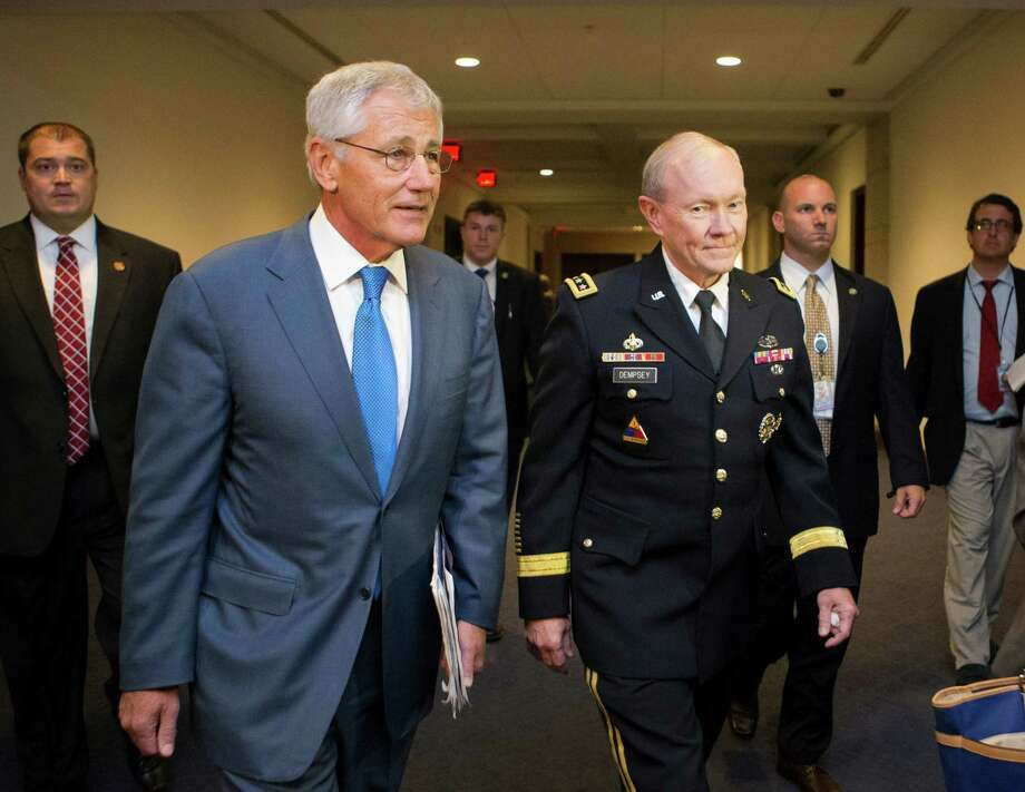 Defense Secretary Chuck Hagel, left, and Joint Chiefs Chairman Gen. Martin Dempsey, right, arrive for a closed-door intelligence briefing with members of the House of Representatives on the situation in Syria, at the Capitol, in Washington, Monday, Sept. 9, 2013. It is the first full day of legislative business for Congress as lawmakers return from the August recess and President Barack Obama is seeking congressional approval for a military strike against Syria for its use of chemical weapons in the civil war. (AP Photo/J. Scott Applewhite) ORG XMIT: DCSA113 Photo: J. Scott Applewhite / AP