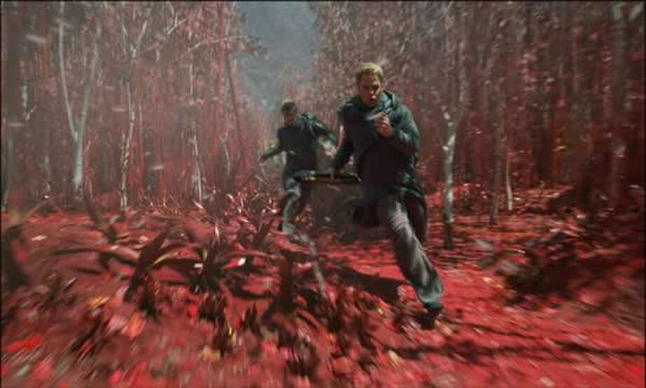 McCoy (Karl Urban) and Kirk (Chris Pine) run through the red jungle of Nibru. Photo: Paramount Pictures, 2013