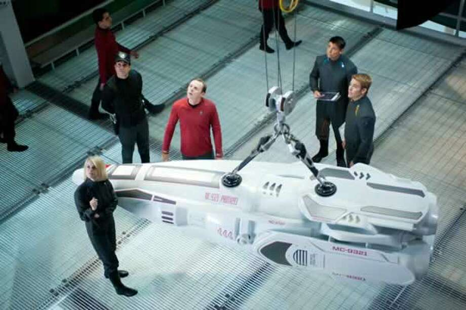 Dr. Carol Marcus (Alice Eve), Scotty (Simon Pegg), McCoy (Karl Urban) and Kirk (Chris Pine) inspect one of Admiral Marcus' torpedoes. Photo: Paramount Pictures, 2013