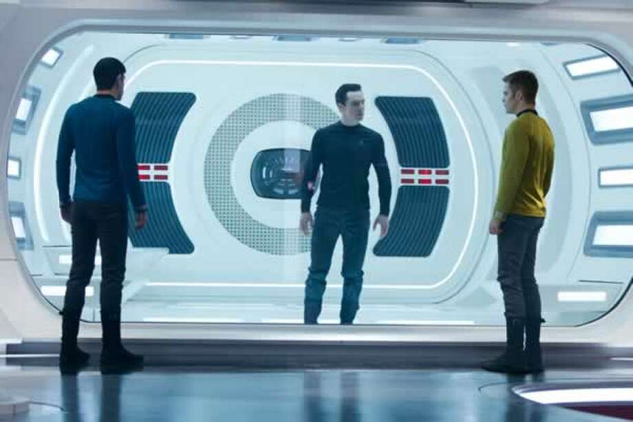Kirk (Chris Pine), Khan (Benedict Cumberbatch) and Spock (Zachary Quinto) in the Enterprise brig. Photo: Paramount Pictures, 2013