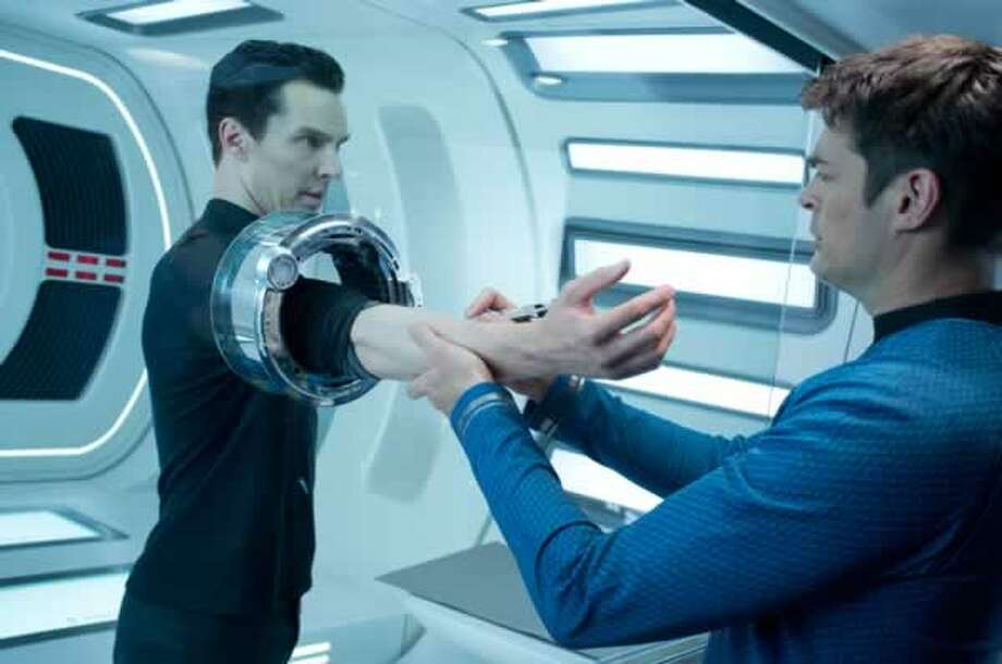Khan (Benedict Cumberbatch) gives a blood sample to McCoy (Karl Urban). Photo: Paramount Pictures, 2013