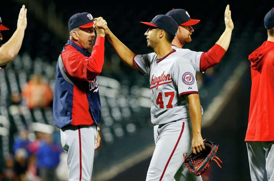 Nationals manager Davey Johnson, left, had an easy night Monday thanks to Gio Gonzalez's one-hitter. Photo: Jim McIsaac, Stringer / 2013 Getty Images