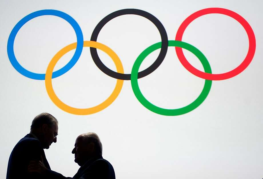 TOPSHOTS - Outgoing International Olympic Committee (IOC) President Jacques Rogge's silhouette (L) is seen as he speaks with IOC member and FIFA President Sepp Blatter under the Olympic Rings during the 125th session of the International Olympic Committee (IOC) on September 9, 2013 in Buenos Aires.  TOPSHOTS / AFP PHOTO / FABRICE COFFRINIFABRICE COFFRINI/AFP/Getty Images Photo: Fabrice Coffrini, AFP/Getty Images