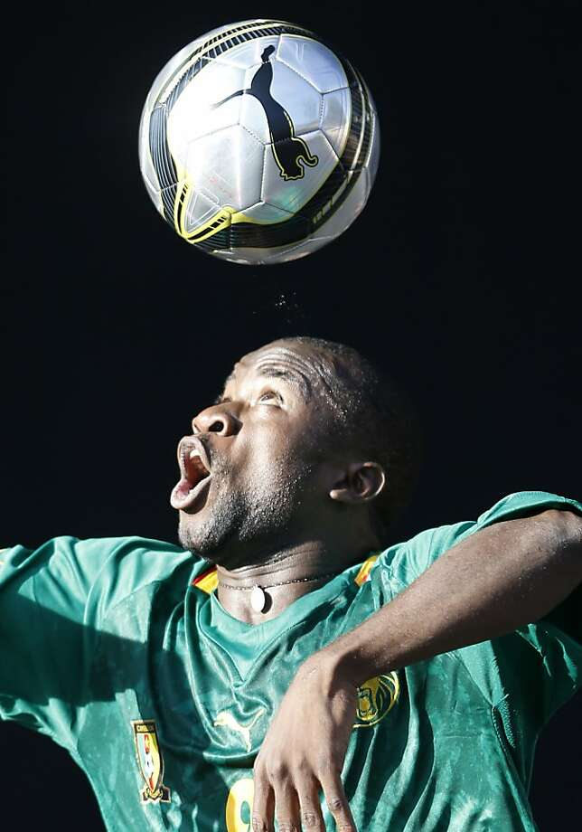 TOPSHOTS - A member of the Cameroon's delegation competes during a Juggling event on September 9, 2013 in Nice, southeastern France, during the VIIth Francophonie Games. The sports and cultural event takes place in Nice until September 15, 2013.  TOPSHOTS / AFP PHOTO / VALERY HACHEVALERY HACHE/AFP/Getty Images Photo: Valery Hache, AFP/Getty Images