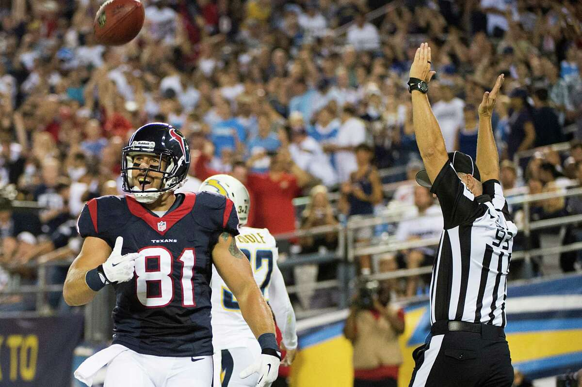 Tight end Owen Daniels (81) puts the Texans on the board with a 1-yard touchdown pass from Matt Schaub in the first quarter of Monday night's game against the Chargers in San Diego.
