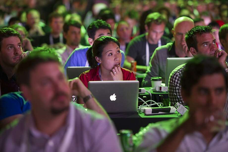 An attendee using an Apple Inc. laptop computer watches a presentation at the TechCrunch Disrupt SF 2013 conference in San Francisco, California, U.S., on Monday, Sept. 9, 2013. TechCrunch, which runs from Sept. 9-11, features leaders from various technology fields and includes a competition for the best new startup company. Photographer: David Paul Morris/Bloomberg Photo: David Paul Morris, Bloomberg